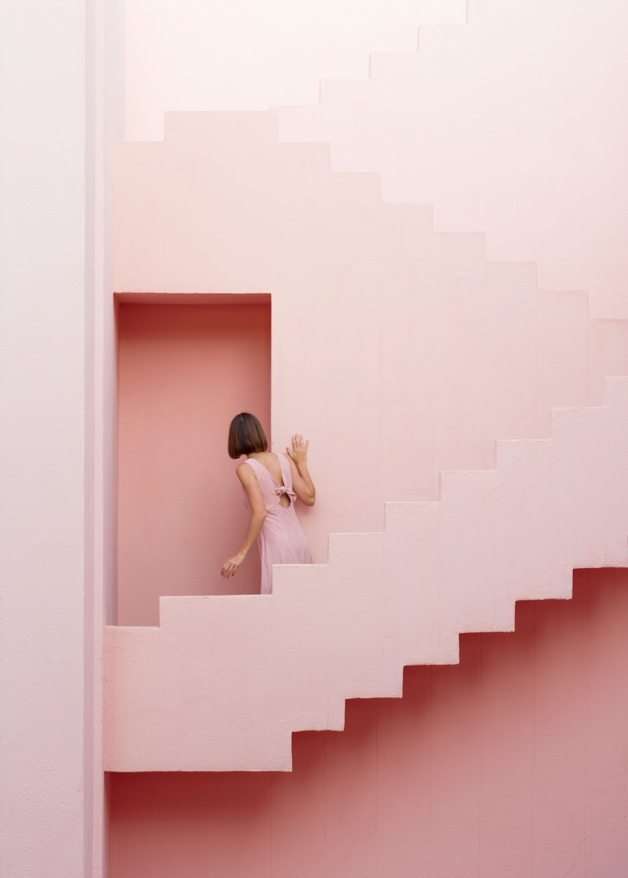 Muralla Roja Ricardo Bofill architect Red Wall Calpe Alicante Spain España Colorful Maze Pink Blue pantone stairs Escher pastel colored building Anniset DrCuerda Anna Devís Daniel Rueda influencer creative campaign